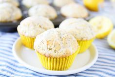 Lemon Poppy Seed Muffins Recipe on twopeasandtheirpod.com These muffins are bursting with lemon!