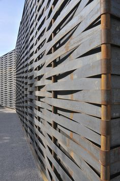 LOVE this! woven metal fence - Kunsthaus Art House Extension  Architects: ssm Architekten ag  Location: Grenchen, Switzerland  Project year: 2005