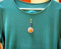 "Stitch A Prayer: ""Mistake Equals Detail"" Add a button medallion to cover up a stubborn spot on a favorite tee."