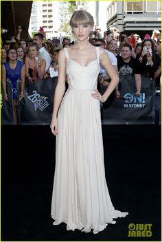 Taylor is wearing an Elie Saab dress, Jimmy Choo shoes, Lorraine Schwartz earrings, and an Ofira bracelet.