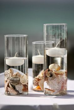 No diy but easy to replicate this shell and floating candle idea for party centerpiece.