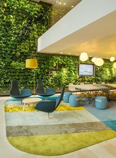 hotel reception lobby interior design green vertical wall rug timber yellow blue