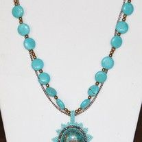 Totally Turquoise Necklace. This is one of my favorite necklaces I've made so far. It has a Turquoise and copper cabochon embroidered with 11/0 and 15/0 seed beads, 3mm bronze firepolished beads. The necklace is made with turquoise cion beads and 4mm bronze rounds beads. Plus, I added a chain for added texture. The clasp is a brass toggle and I added a brass turtle charm on the back.