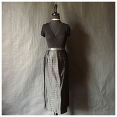 This is a beautiful NINA MASSINI brand black/gray Ruffle styled long skirt.    SIZE - Label Size: 12    Appearance Size: Medium-Large    (Contains a slightly stretchy waist band)    MATERIALS  100% Polyester    MEASUREMENTS:  Length: 32 3/4 inches  Waist: 30 inches    CONDITION  This featured skirt is in overall good/excellent condition. (98%)    **This item normally sells for $100. Great deal at $19.99!    This black Nina Massini skirt is ABSOLUTELY BEAUTIFUL! With its solid ruffle styled…