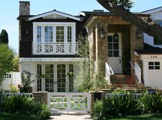 Exterior, : Gorgeous Ranch House Curb Appeal With White Wooden Door With Glass Panel Also Natural Stone Pillars And Cool Vintage Lantern Front Porch Lamp White Wooden Doors, Porch Lamp, Craftsman Exterior, Level Homes, Newport Beach, Laguna Beach, Ranch Style, My Dream Home, Dream Homes