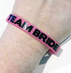 Show the bride your support with these fun rubber bracelets. The bracelets are pink and black and one size fits most. Get one for everyone to wear to the bachelorette party.