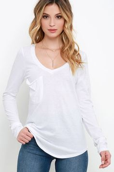 We love a good sweater or coat, but a layer as cute as the Secret Layer Ivory Long Sleeve Top is meant to be shown off! Burnout ivory knit sweeps across a rounded V neckline, into a relaxed bodice with patch pocket, and long fitted sleeves. Rounded hem adds a cute touch to this essential basic!