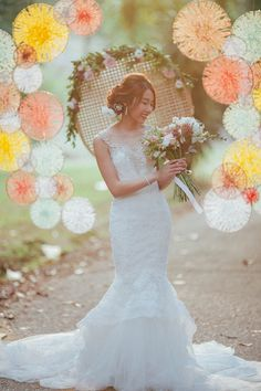 Willow hoops with criss-crossed string art as wedding backdrop // Bridal Portraits With a Backdrop of Colourful String Art