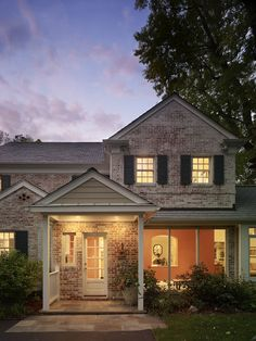White washed brick traditional house exterior + Silver Spring, Maryland + Carnemark+ Photography by Maxwell MacKenzie