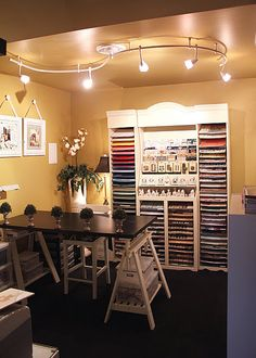 OK, love the lighting and I want this to be what my second table is like - black, but longer (seating at least six!) :) for all those scrapbooking friends I have! :)