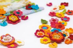 Crochet flower tutorial from Mollie Makes (UK terms - US/UK translation http://www.yarnfwd.com/crochet.html)