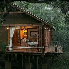 I wish I had a magic wand, so with one swish, I'd be right here. There's something so appealing to me when I see a home/cabin tucked away in the woods. Just love it!