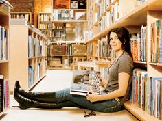 """Lauren Graham in Redbook mag. sitting on the floor of one of her favorite bookstores, Hennessey + Ingalls in Hollywood. She's been going there since she was a child. As she noted, """"There was eating, sleeping -- and then there was reading. It was the one thing I could do in the day that was totally gratifying. I still have a bunch of my childhood books. I don't understand a house that doesn't have books."""""""