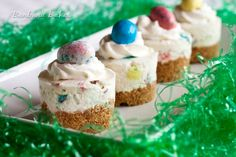 Robin Egg No-Bake Cheesecake Recipe - Cute little, light and fluffy mini no-bake cheesecakes on a graham cracker crust loaded with chunks of chocolate covered malted milk balls dressed up for Easter.