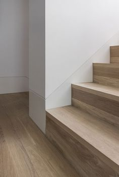 E Architecture's flush skirting detail meets with the timber staircase in one of our projects Timber Staircase, Staircase Railings, Wooden Staircases, Staircase Design, Spiral Staircases, Stairs In Living Room, House Stairs, Stair Treds, Stairs Skirting