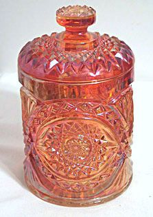 Here is a nice No. 282 covered biscuit jar in the newer carnival made by Imperial. It is from the Americana series and is an imitation cut glass Hobstar pattern. The color is rubigold and it is marked