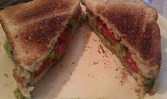 Hummus, avocado and tomato sandwich. Spread hummus on toast. Add 1/2 mashed avocado and a couple slices of tomato.