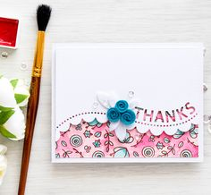 """Pink and teal water colors stand out from the rose gold embossing.  Stamps from the """"Hello Friend"""" set are scattered on the bottom layer, while the Thanks Scalloped Border die shows a peek from the white top panel. DIY Thanks card"""