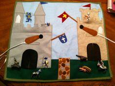 Felt Play Mat: A Roll-Up Castle Themed Play Mat with toys. $40.00, via Etsy.
