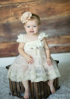 A NEW line exclusively for infants 3-6, 6-12 and 12-18 months STunning lace ruffle cap sleeves with ruffle lace top. Chiffon bodice with slip