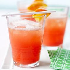 June Bug - Icy-cool scoops of sherbet give this refreshing, nonalcoholic drink its sweet fizziness, while grenadine and OJ pair up to create its pretty coral color.