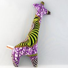 Plush Giraffe Rattle Toy in purple African batik print by miniandmono. Great for Kwanzaa, Birthday Parties, or year round fun &Games with Animal Characters! African Babies, Unique Gifts For Kids, African Crafts, African Accessories, Fabric Bracelets, Batik Prints, African Fabric, Sewing For Kids, Textiles
