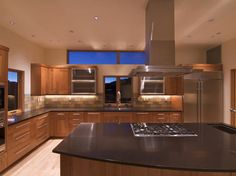 Neutral color scheme and massive kitchen island. Stirling Ranch House by Black Shack Architects