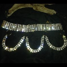 SUPER RARE fausto puglisi SWAROVSKI  CRYSTAL BELT You will not see another belt like this one anywhere not one as blingy as this belt. It is made by fausto puglisi all done in swarovski crystals and was featured in Vibe magazine sept 2000. I have posted the magazine info in another ad on here. This belt is absolutely stunning. It cost $2600 which you will see in the ad. It did have the crosses on it but I took them off when I wore it because they were so huge and weighed a ton. They were…