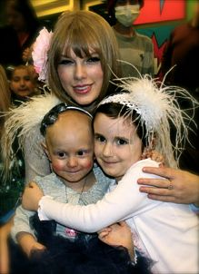 Taylor Swift wearing Brooke's personal blossom that she gave her.... sharing one gift from the heart to another