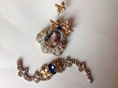 victorian bracelet and brooch set The fairy face of woman, cabochon under glass,  swarovski and aurora rhinestones, Miriam Haskell elements