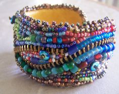Beaded cuff for DIY beadl fabric and line with leather. could also make pendant this way
