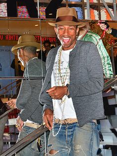 "Star Tracks: Wednesday, April 30, 2014 | RETAIL THERAPY | A very ""Happy"" Pharrell Williams celebrates his new apparel collection for Uniqlo (entitled ""i am OTHER"") at the retailer's flagship store in New York City on Monday."
