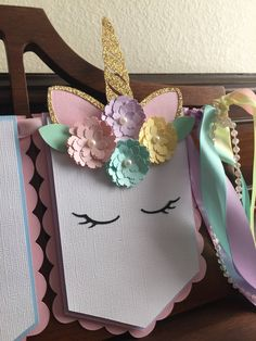 PLEASE READ BEFORE PURCHASING: CURRENT TURN AROUND TIME IS 3-4 WEEKS. This beautiful banner will add the perfect touch to your event. This unicorn theme banner is done with light pink, lavender, light blue, aqua and light yellow to represent the colors of the rainbow. Each pendant
