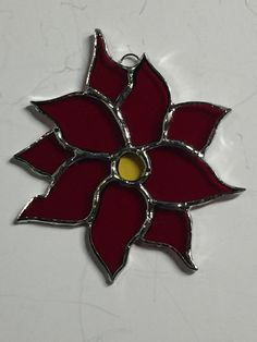 Christmas Stained Glass Poinsettias, Christmas Ornaments, Poinsettia Sun Catcher  This beautiful Christmas Red Poinsettia measures approximately 4 x 4. 10 pieces of stained glass create this poinsettia. Red leaves with a yellow throat will add color to your tree or window as a sun catcher.  If you need additional quantities , please convo me and we will set up a special order to accommodate your needs.