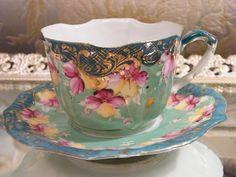 antique floral tea cup