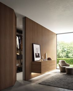 New wall paneling from Moderne Living reinvents the very concept of wall cladding, in a more amplified and contemporary way. Wall Cladding Interior, Wood Cladding, Interior Walls, Home Interior Design, Interior Lighting, Interior Plants, Hidden Doors In Walls, Living Room Designs, Living Room Decor