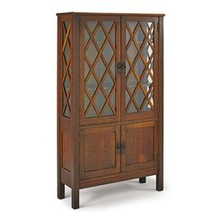 "Gustav Stickley (1858-1942) - Four-Door China Cabinet. Quartersawn Oak and Glass with Hammered Copper Hardware.  Eastwood, New York. Circa 1915.  62"" x 35-1/2"" x 12-1/2""."
