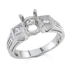 BF1382 - #23332  18 k, white diamond ring 0.13 ct. rounds 0.26 ct. princess (Please call for pricing)