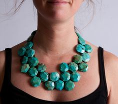 Turquoise faceted stones sewn onto brown leather - ties in back