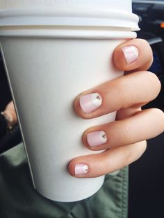 Half moon manicure. Love the pink and white with the gold glitter dot!