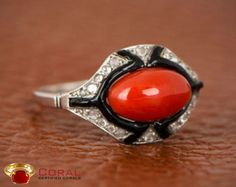 This coral with onyx studded diamond ring will enhance your style.