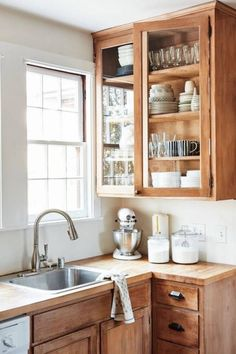 Modern Kitchen Interior Remodeling cute natural wood kitchen cabinets - A glimpse inside this historic home's modern revamp. Natural Wood Kitchen Cabinets, Farmhouse Kitchen Cabinets, Wood Cabinets, Kitchen Wood, Glass Cabinets, Diy Kitchen, Country Kitchen, Kitchen Cupboards, Kitchen Corner