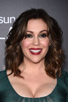 Alyssa Milano Medium Wavy Cut with Bangs - Shoulder Length Hairstyles Lookbook - StyleBistro