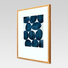 With watery blue hues and abstract shapes, the Framed Abstract Blue Watercolor from Project 62™ adds cool intrigue to your wall decor. With the modern white matting, thin wooden frame and blue watercolor design, this wall art is perfect as part of a gallery wall or console display.<br><br>1962 was a big year. Modernist design hit its peak and moved into homes across the country. And in Minnesota, Target was born — with the revolutionary idea to celebrate design ...