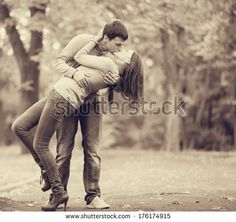 images of couples kissing in a park | couple kissing outdoor in the...