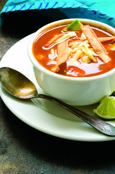 Homesick Texan's tortilla soup - made Oct 2013 Minus some of the peppers so the kids could eat it.
