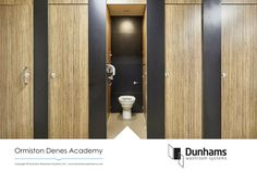 An excellent example of an open plan washroom design using Dunhams' Altitude toilet cubicle system