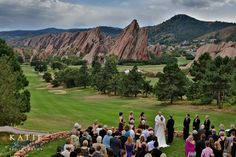 Amazing view of the Arrowhead Golf Course in Littleton, Colorado of a wedding ceremony.  Gorgeous moment with bride and groom.  Katie Corinne Photography