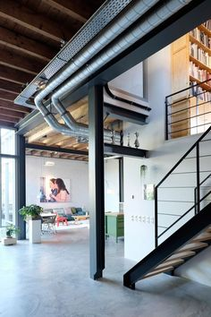 Houben & Van Mierlo Architecten converts former potato barns into loft-style homes   industrial loft house   residential interior design   modern living room with artwork