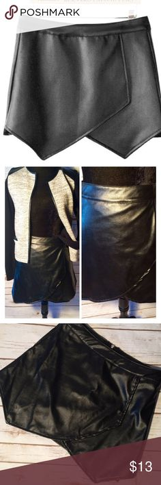 """Faux Leather Wrap Look Mini Skirt Black faux leather mini skirt. Wrap look, fully lined, rear zipper.  Asian size large. Worn once by my daughter. Probably fits more likens medium. Approx measurements while lying flat: waist 14 1/2, length 13 1/2-15"""" at shortest and longest points. Skirts Mini"""